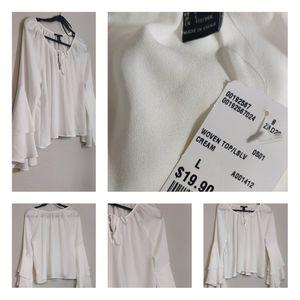 Ivory double bell sleeve peekaboo blouse